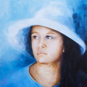 portrait of a young girl wearing a white sunhat